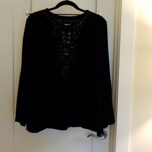 Velvet top with jewel neckline.